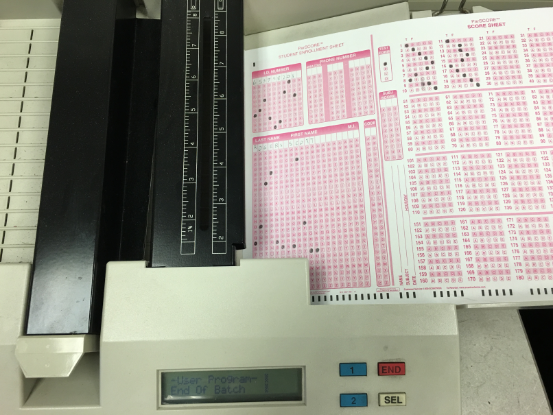 Place the student answer forms with Side 1 facing up in the scanner.