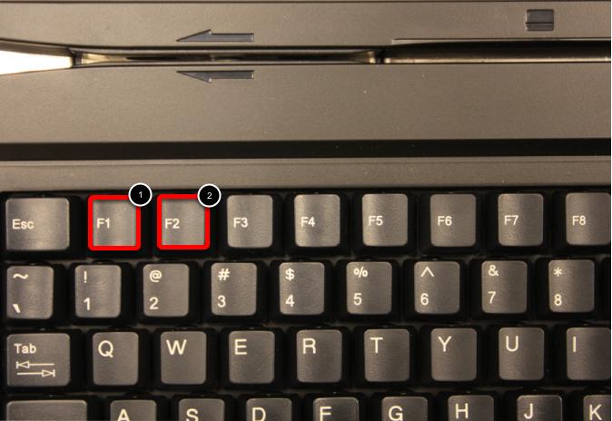 Locate F1 / F2 keys on the top row of keys on the keyboard.