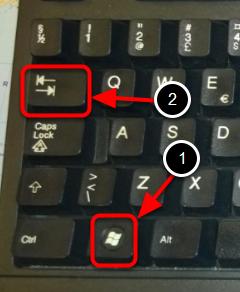 Hold Windowstasten og tabulatortasten nede samtidigt