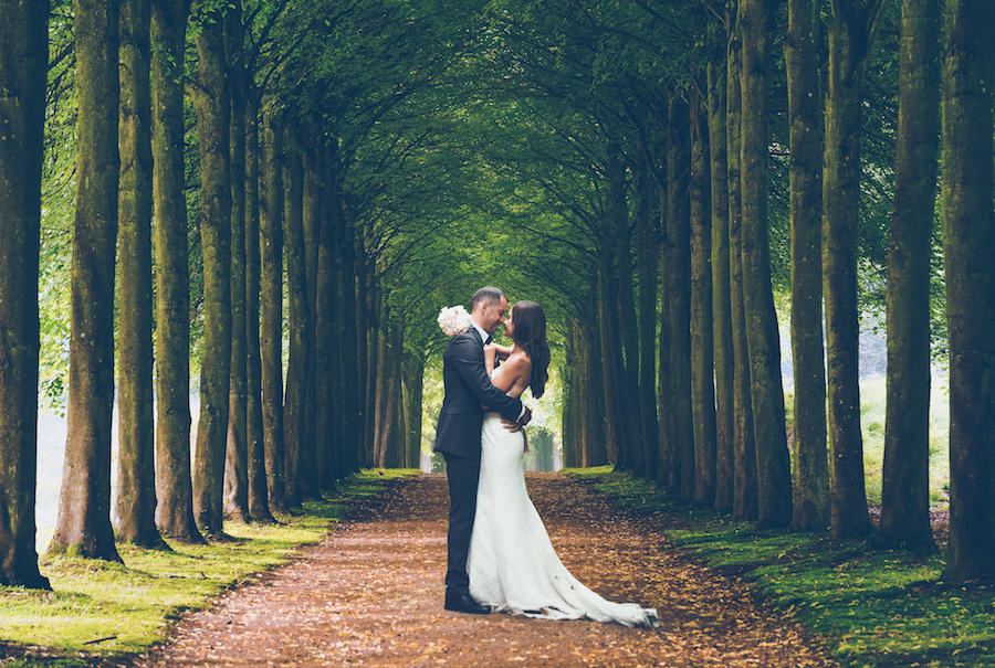 couple portraits tall trees