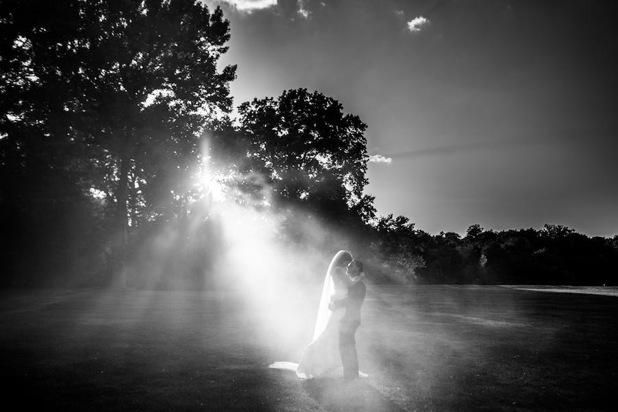 sunset on a couple portrait in a black and white photo