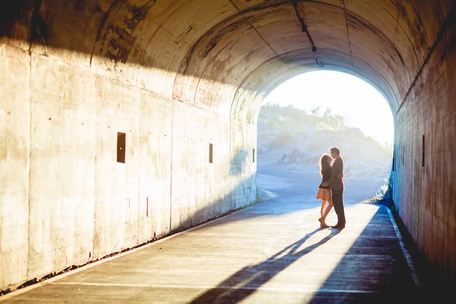 engagement shot in a bright tunnel