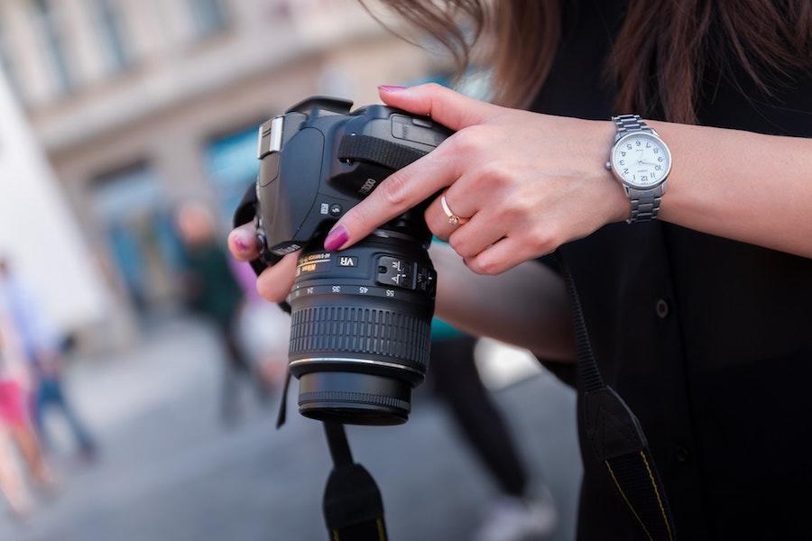 woman holding professional camera