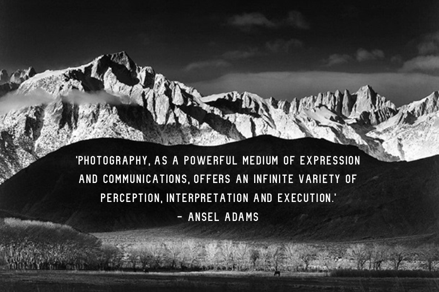 One of Ansel Adams' inspirational quotes about photography on a black and white wide shot of a mountain and the clouds in the sky.