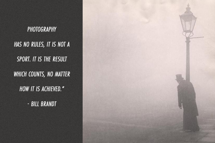 A inspirational photography quote from photographer Bill Brandt on a black and white image of man with a top hat standing next to a street light.