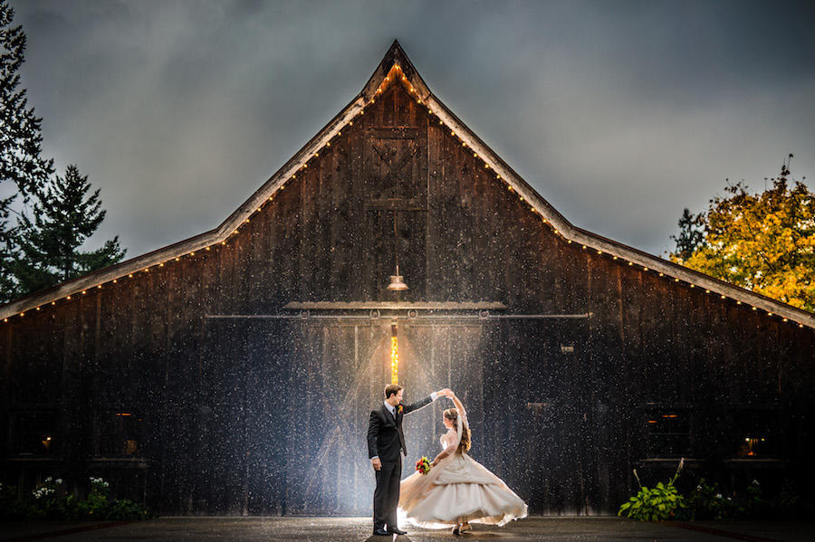 rainy couple portrait in front of barn