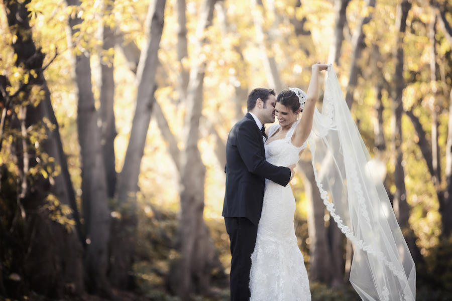 outdoor couple portraits with bride's veil