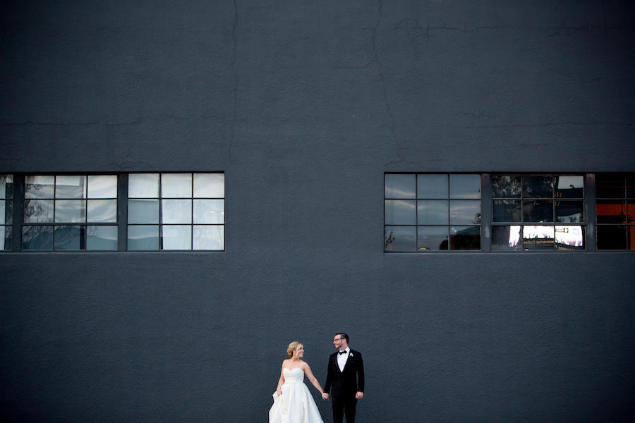 couple portraits in front of building