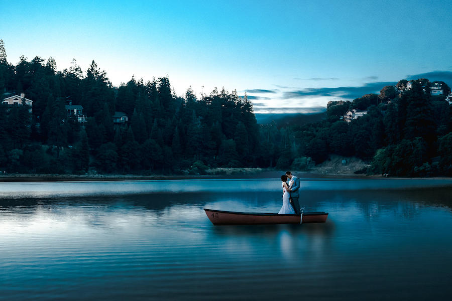 couple portraits lake canoe