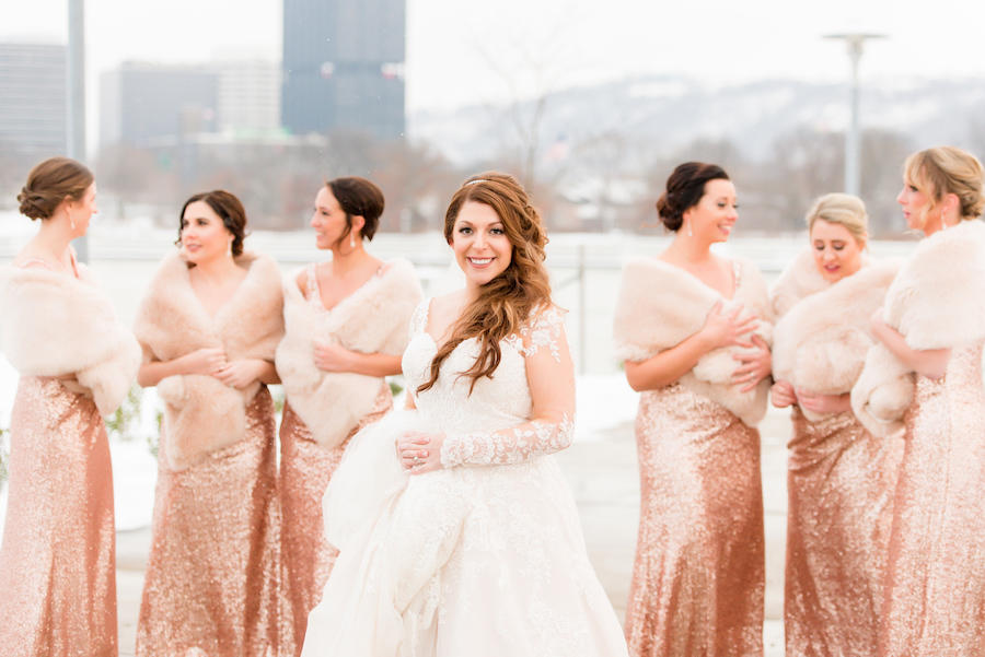 bride and bridesmaids outside snowing