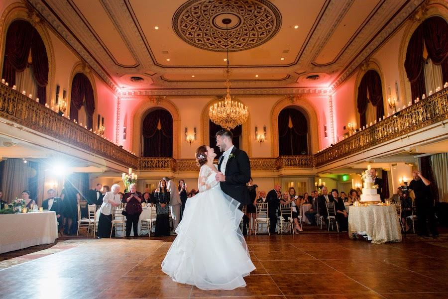 side view of bride and groom's first dance