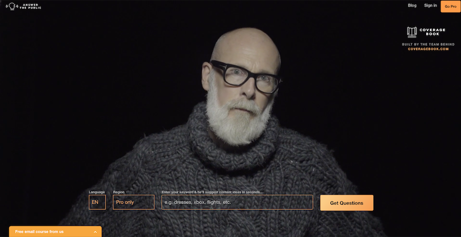 Answer the public homepage with a bald man with black glasses and a white beard looking straight ahead.