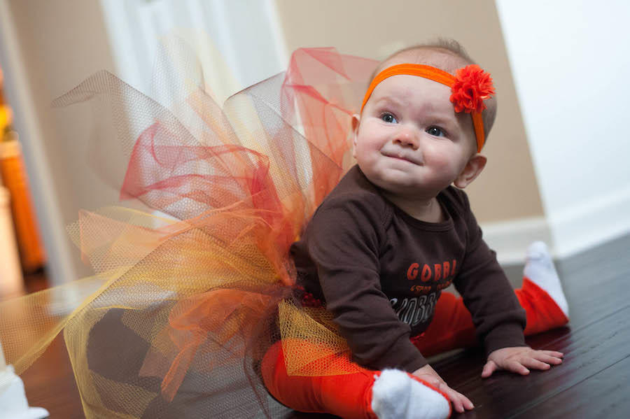 An image by Leeann Marie, Wedding Photographers of her daughter in a Halloween outfit.
