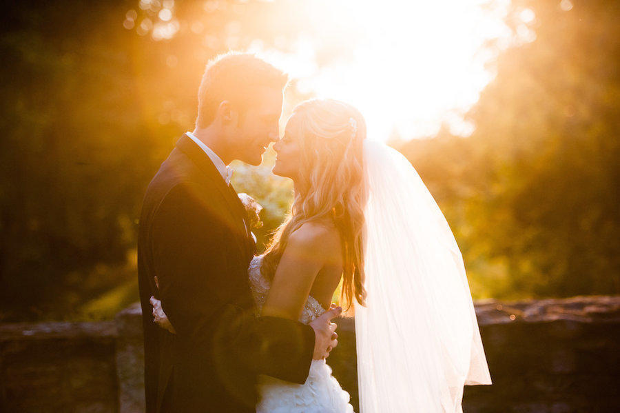 A wedding portrait of the bride and groom with sunflare by Leeann Marie, Wedding Photographers.