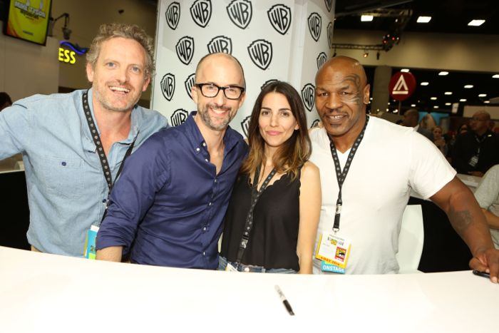 MIKE TYSON MYSTERIES producer Hugh Davidson, Jim Rash (voice of the Marquess of Queensberry), Rachel Ramras (voice of Yung Hee, Mike's adopted daughter) and Mike Tyson during the MIKE TYSON MYSTERIES signing in the Warner Bros. booth at Comic-Con 2014