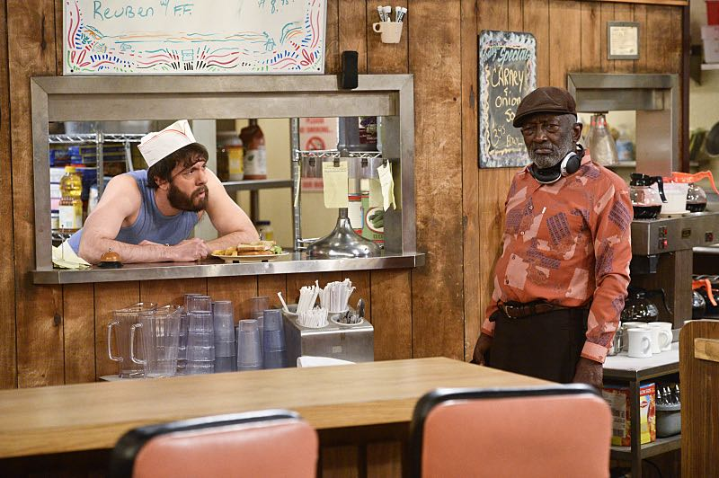 """""""And the Pity Party Bus"""" -- Pictured: Oleg (Jonathan Kite) and Earl (Garrett Morris). The girls' Hollywood adventure continues as Caroline signs away the rights to her life story so it can be turned a movie. Also, Max is heartbroken when Randy breaks up with her via his therapist, and Caroline rents a party bus in an attempt to cheer her up, on 2 BROKE GIRLS, Thursday, March 31 (9:30-10:00 PM, ET/PT) on the CBS Television Network. Photo: Darren Michaels/Warner Bros. Entertainment Inc. © 2016 WBEI. All rights reserved."""