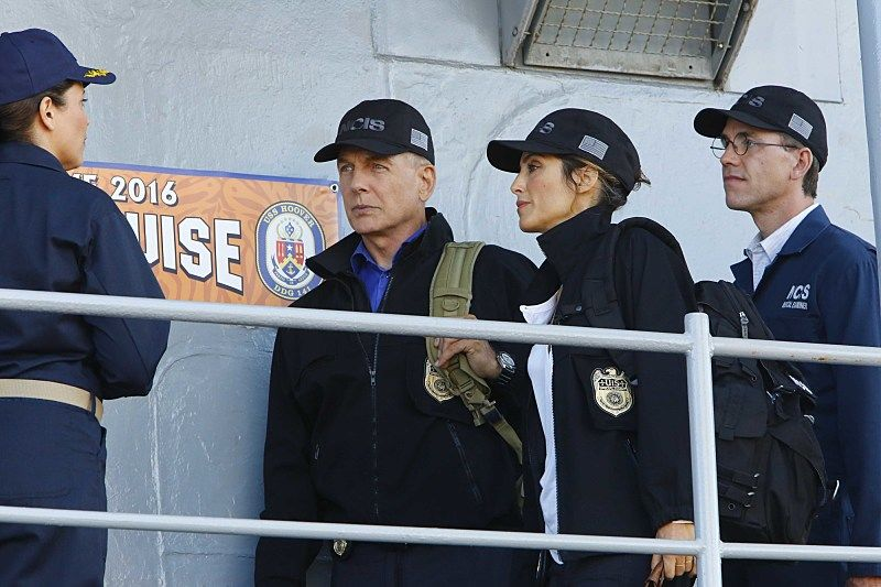 """Love Boat"" -- After the body of a navy lieutenant is discovered aboard a destroyer during a tiger cruise, when civilian guests are allowed to spend the night on the ship, Gibbs, Quinn and Palmer travel out to sea to investigate. Also, McGee contemplates the perfect proposal for Delilah Fielding (Margo Harshman), on NCIS, Tuesday, Oct. 11 (8:00-9:00 PM, ET/PT), on the CBS Television Network. Pictured: Mark Harmon, Jennifer Esposito, Brian Dietzen.  Photo: Bill Inoshita/CBS ©2016 CBS Broadcasting, Inc. All Rights Reserved"