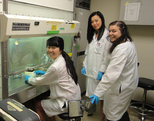 Emily Pang (left) with lab technicians at Stony Brook University