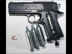 A BB gun with pellets