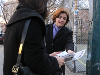 City Council Speaker Christine Quinn handed out flyers with the description of two men who were wanted in connection with a West Village hate crime.