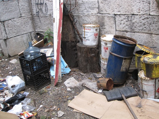 Trash has accumulated inside the gatekeeper's quarters of the Seaman-Drake Arch.
