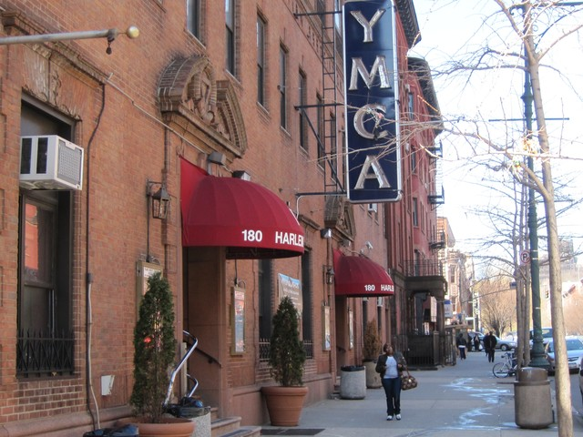 Two men were shot, one of them fatally, across from the Harlem YMCA Monday night, according to police.