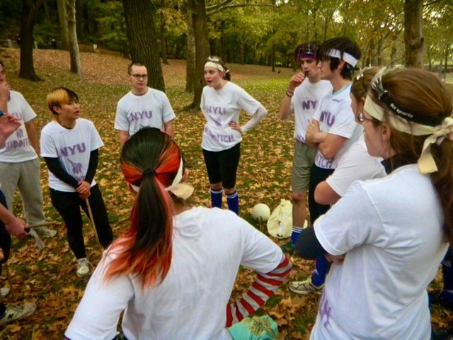 Quidditch players discuss strategy before the game.