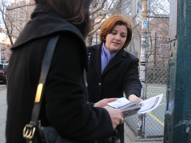 City Council Speaker Christine Quinn handed out flyers about Sunday morning's alleged anti-gay attack.
