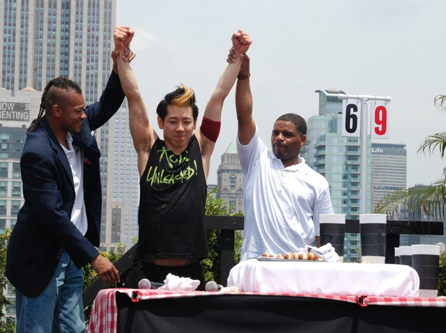 The judges declare Takeru Kobayashi the victor at an alternative hot dog eating contest in the Flatiron, July 4, 2011.