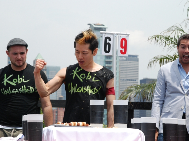 Takeru Kobayashi inhaled 69 hot dogs in ten minutes, besting the official candidates in the Coney Island Hot Dog Eating contest by seven dogs.