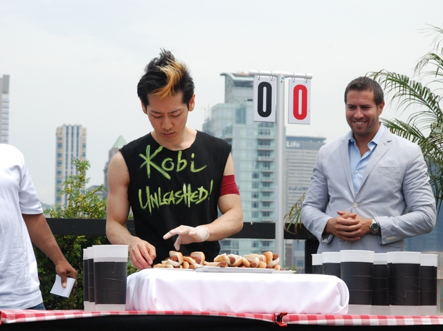 Hot dog eating champ Takeru Kobayashi prepares himself for the dueling contest on July 4, 2011.