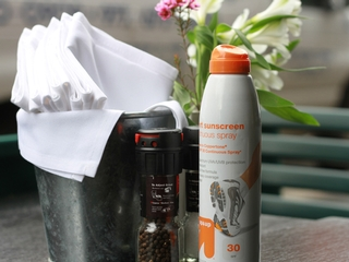 Fiddlesticks in the West Village puts Up and Up — a Target store brand — 30 SPF sunblock on its outdoor tables.