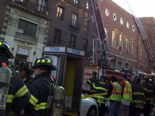 Building residents and firefighters outside 2720 Broadway.