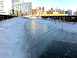 Clearing Ice on High Line Requires Hard Labor and Sunshine