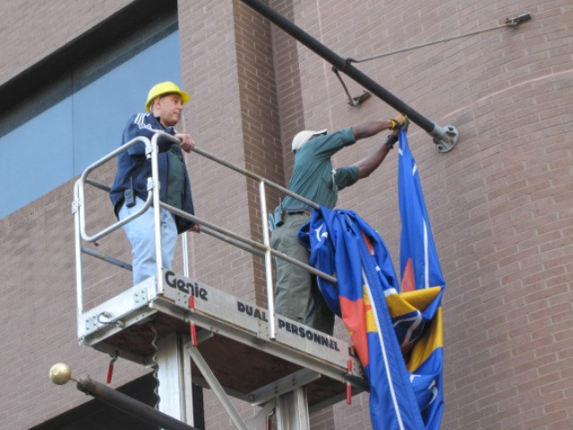 A St. Vincent's flag was taken down from the hospital site after it was shuttered.