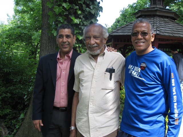 Assemblyman Adriano Espaillat visited with volunteers and thanked Jack Reynolds, father of Bruce Reynolds, a Port Authority Police Officer who had tended to the garden and the area throughout his life. Bruce Reynolds died on September 11th. Robert Jackson stands with the pair in the garden.