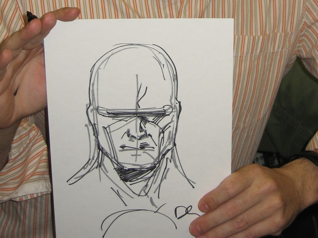 Comic Artist Dennis Calero shows off a free sketch of Dr. Solar he did for a lucky fan.