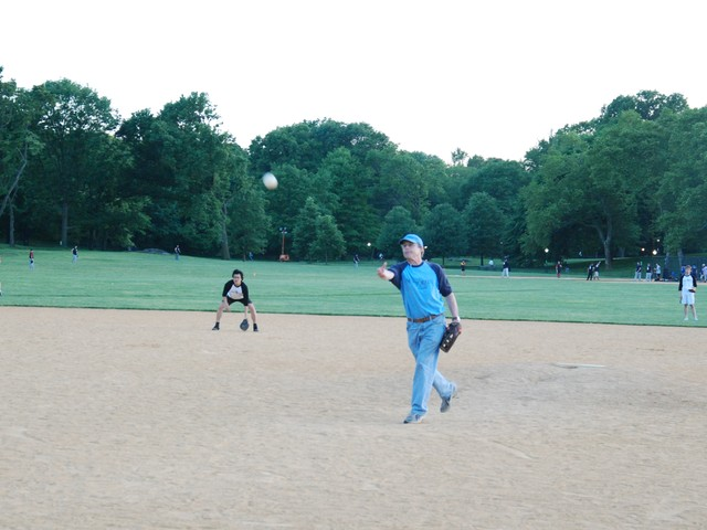 Hendrik Hertzberg, senior editor for the New Yorker, pitched a few innings at Tuesday's game against Vanity Fair.