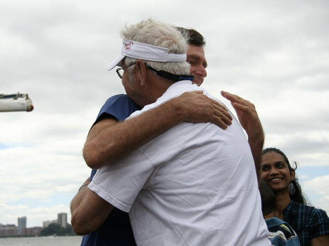 Reid hugs his father after arriving on Pier 81 in Midtown.