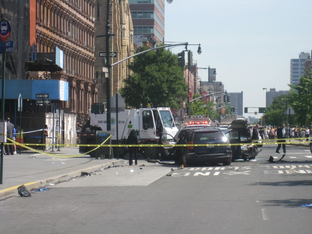 The scene at Lenox Avenue and 122nd Street where a getaway car struck and killed a nun.