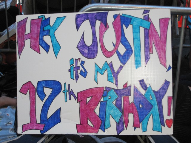 Fans made posters, t-shirts, and wrote on their faces and bodies for Bieber's concert.