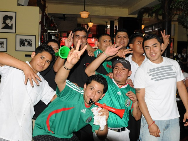 Mexican staffers celebrate the first goal.