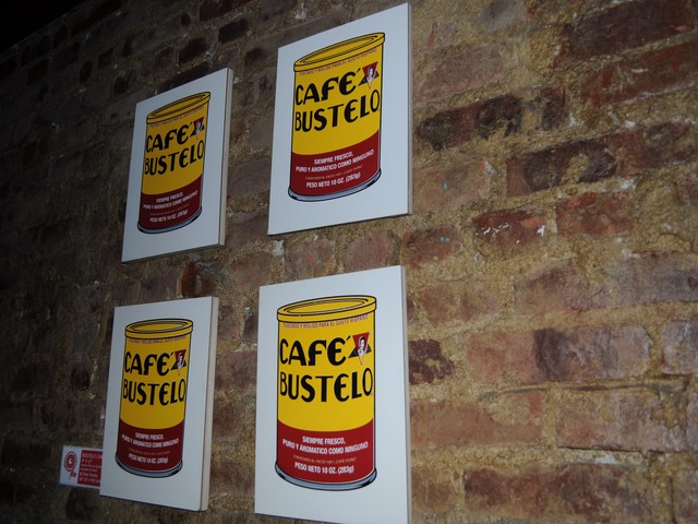 Perlata plays with other iconic items in his art, in this case arranging Cafe Bustelo cans in a style similar to Andy Warhol's Campbell's Tomato Soup  art.