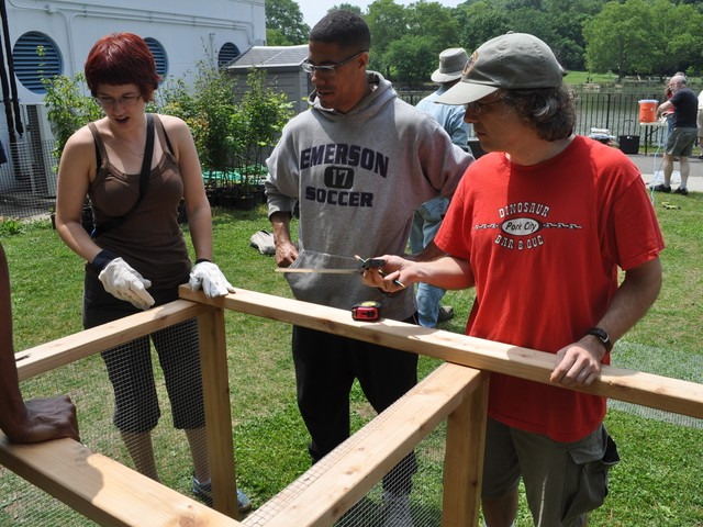 Katie Clifford, Adam Garrett-Clark and Vincent Marquardt help build compost bin.