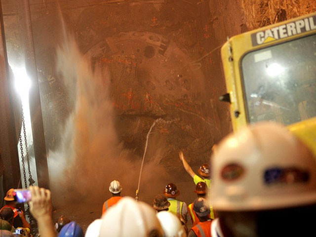 A boring machine breaks through the earth below Port Authority.