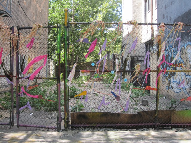 The fence in front of the lot was covered in colorful ribbons and cutouts of rats by the Lower Eastside Girls Club over the summer.