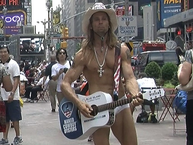 The Naked Cowboy returned to Times Square after his announcing his lawsuit against Sandy Kane.