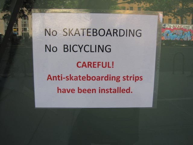 A sign warns skaters of the new strips.