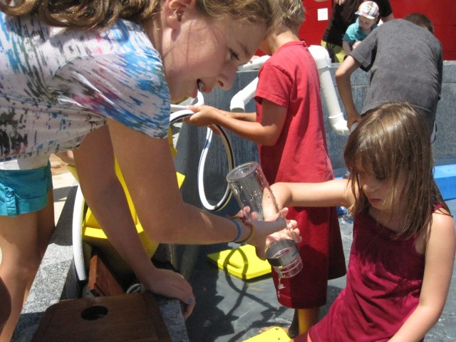 Kids used tubes and bottles to funnel water to their various projects.