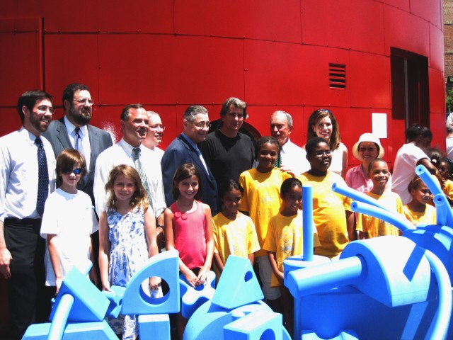 Architect David Rockwell, Mayor Michael Bloomberg, Assembly Speaker Sheldon Silver and other local political leaders stand behind the playground's signature blue foam blocks.
